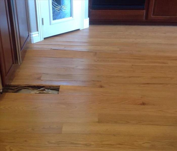 Damaged Wood Flooring From Water Damage After