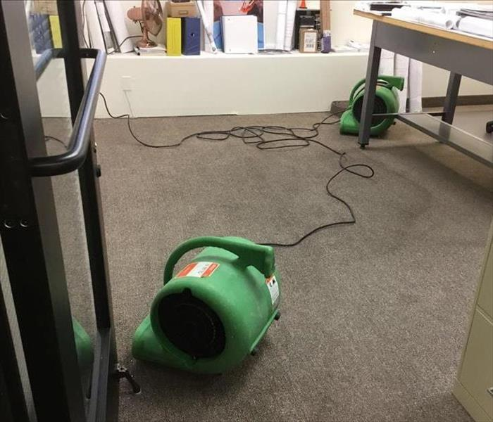 Air Movers Drying Down Water Damaged Areas